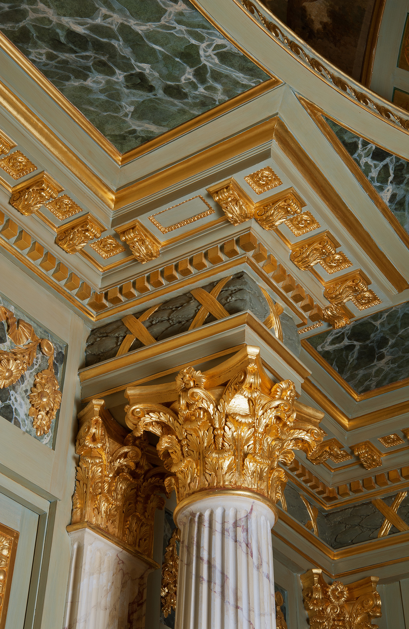 Carved stone capital and cornice, white paint and imitation gray marble finish, fine gilding