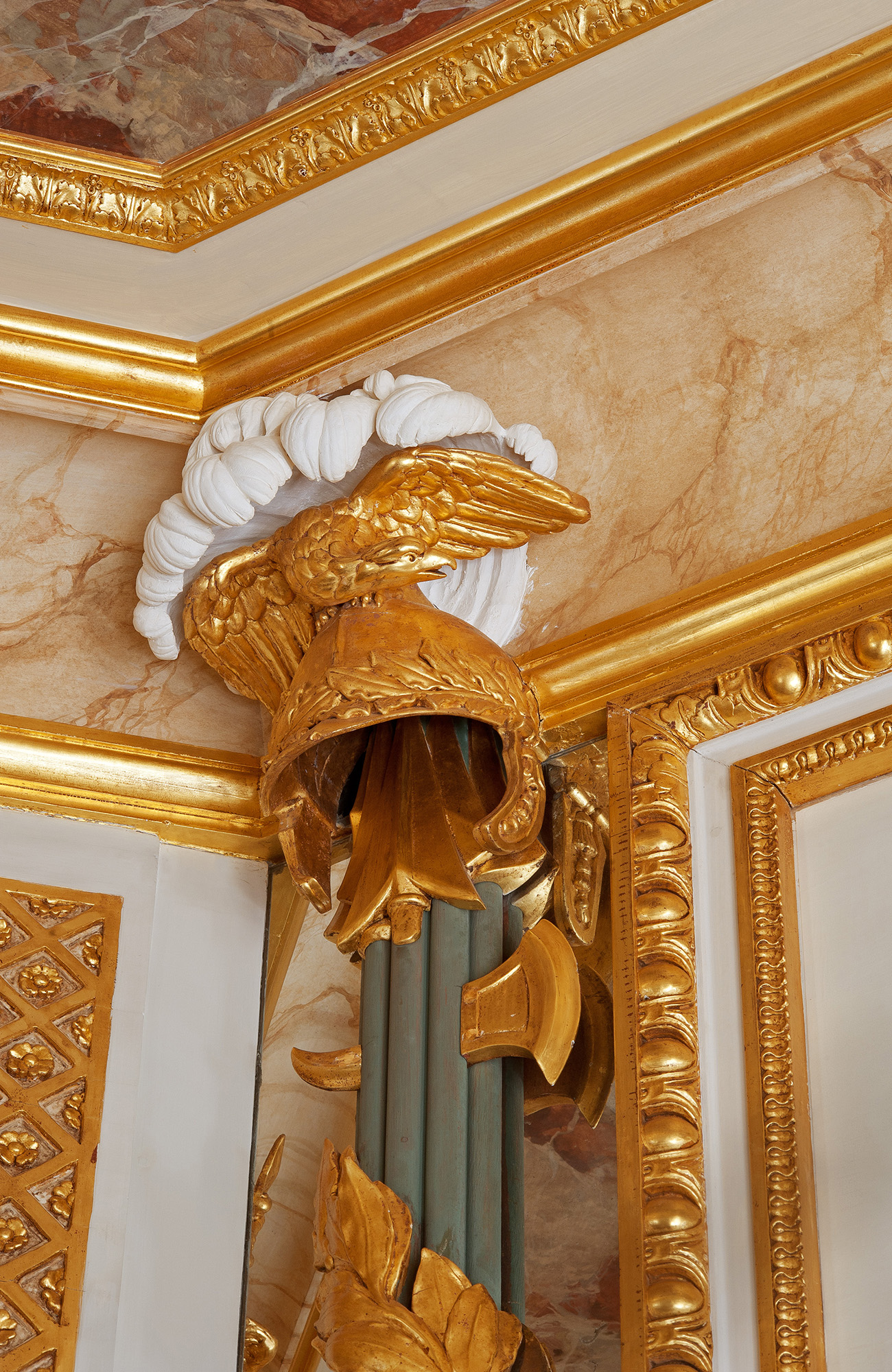 Helmet-and-arms capital from Ledoux boiserie, cornice and ceiling paintwork in white, gold, and faux russet marble