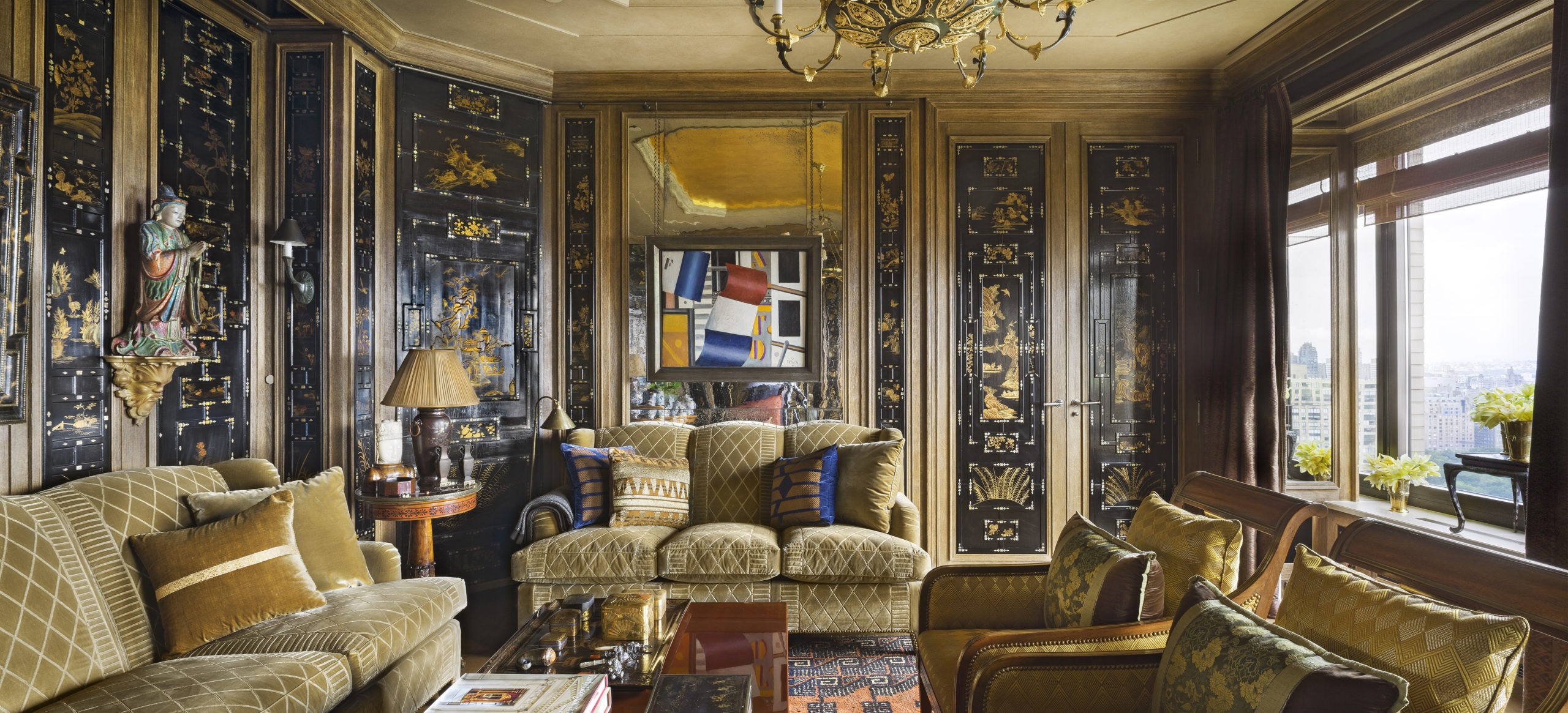 Black and gold Canton lacquer woodwork, largely redone by Féau Boiseries to adorn the small living room of a Manhattan apartment