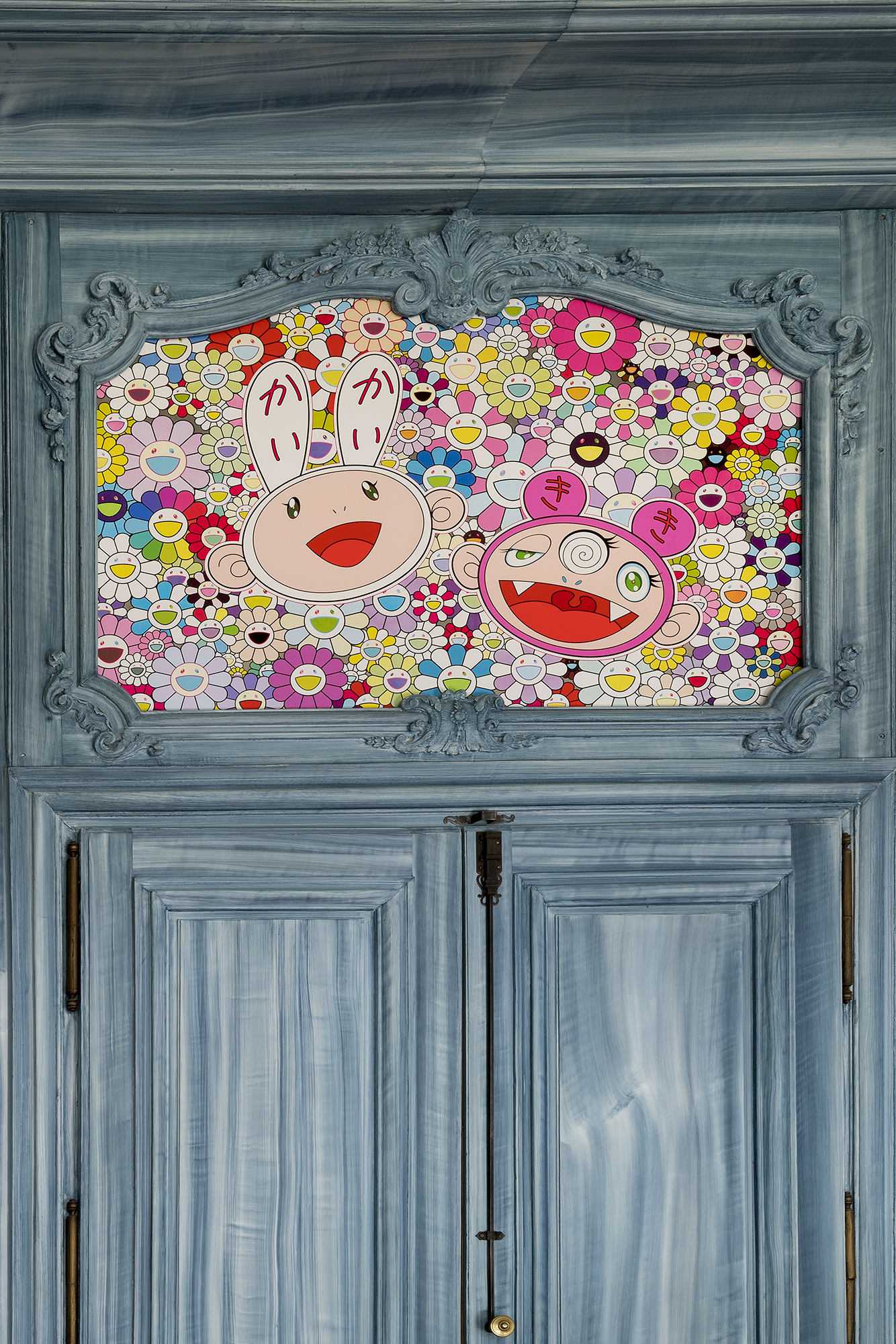 Detail of a dining room Louis XVI boiserie scheme enhances by Takashi Murakami artwork