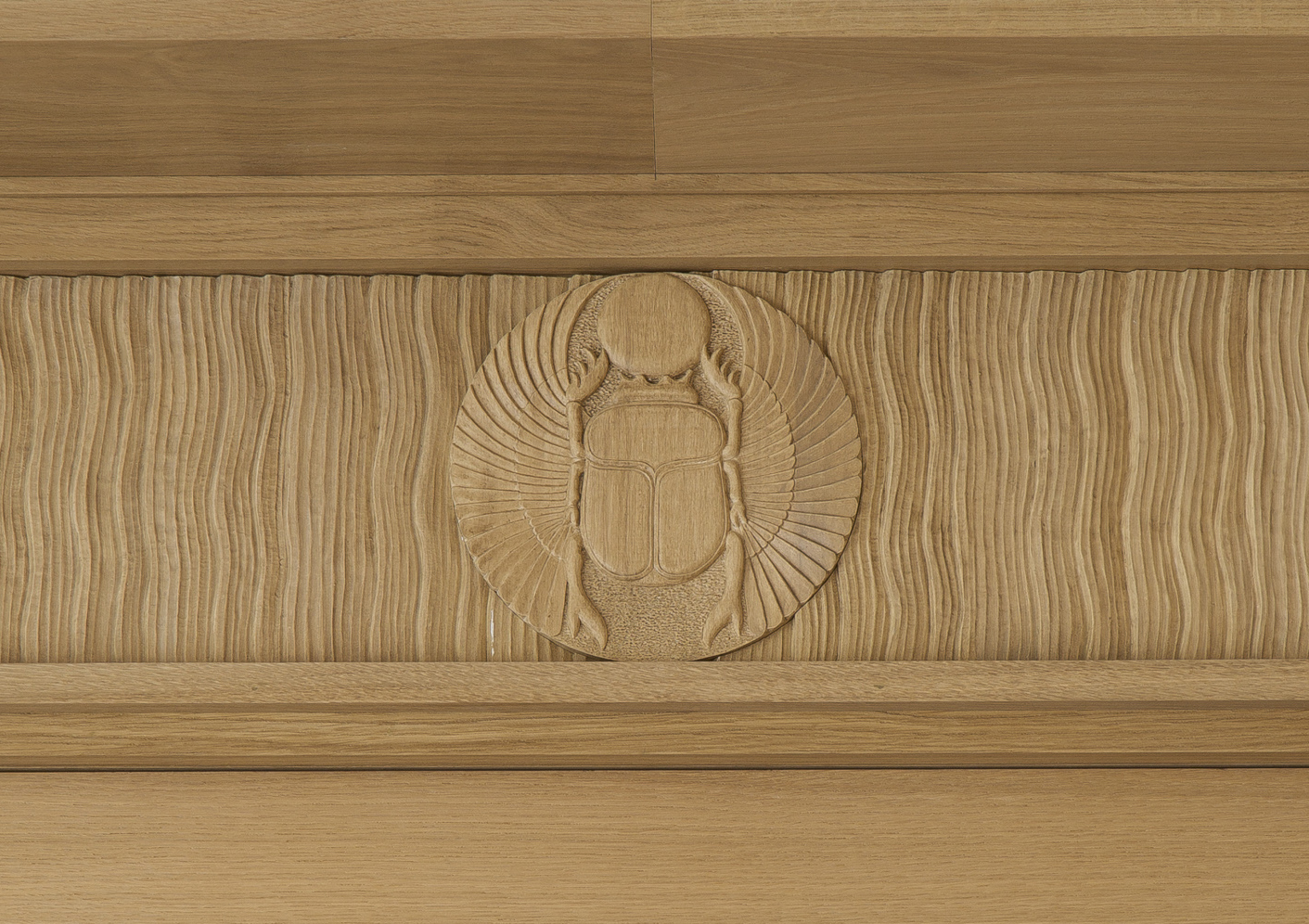 Detail of an Art Deco inspired cornice, with sculpted scarabs, created for interior decorator Pierre Yovanovitch